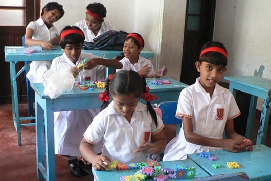 Some simple toys and puzzles brought big smiles in the special needs classroom.